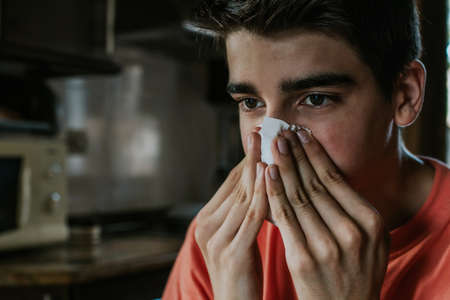 young man with the scarf with a cold or allergy