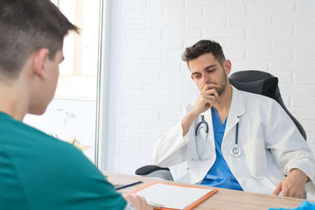 doctor with the patient in the clinic or consultation