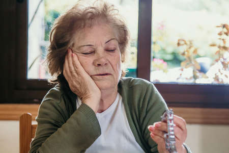 portrait of an older woman looking at the clock