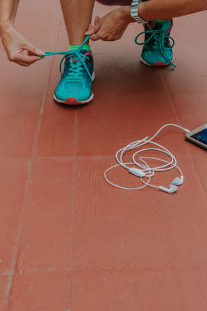 runner preparing for the race or training with the mobile phone
