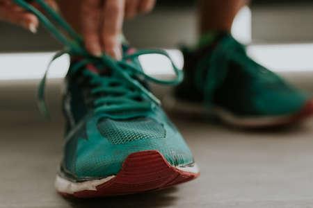 runner tying his shoe to do sports Stok Fotoğraf