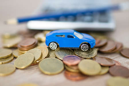 car with coins and calculator, expenses and car purchase