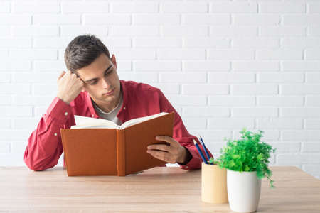 student with book at home or school table