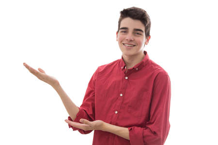 young man or teenager isolated on white pointing with hands