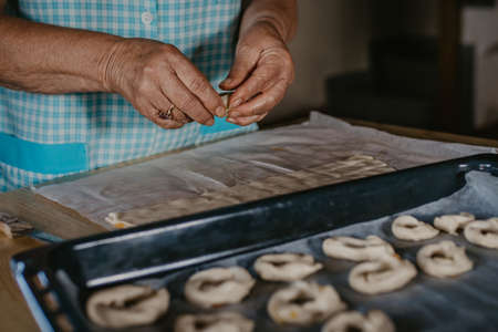 hands cooking making donuts or traditional sweets 写真素材