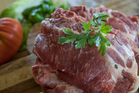 fresh veal chop meat on wood