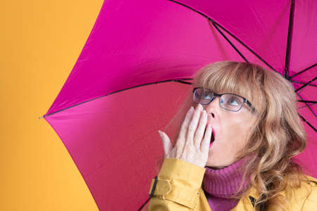 adult woman with umbrella and surprise expression