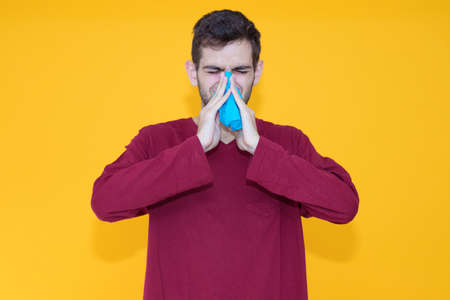 man with handkerchief and allergy or cold isolated on color background Foto de archivo