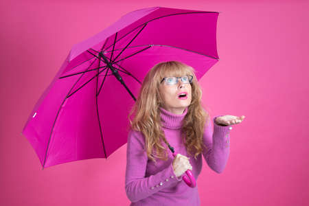 adult woman with umbrella on color background