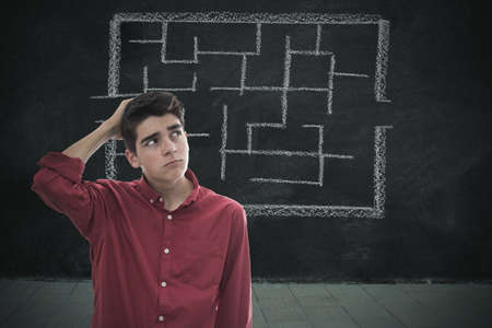 portrait pensive young man with maze background