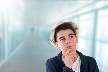 portrait of thoughtful boy in school or indoors Stok Fotoğraf