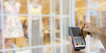 hand with credit card and payment terminal in the store Stock fotó