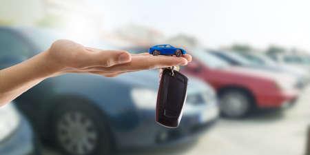 hands with keys or car control, buy car Banco de Imagens