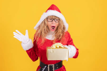 santa claus with gifts and surprise expression