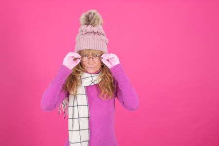 adult woman with glasses and warm clothes