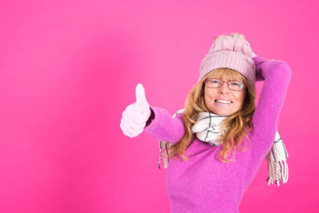 adult woman with warm clothes isolated on color background