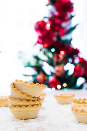 sweets and cakes with christmas tree background