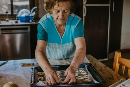 lady or grandmother preparing christmas candy or cakes Archivio Fotografico