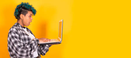isolated smiling girl with laptop and space in color background Archivio Fotografico