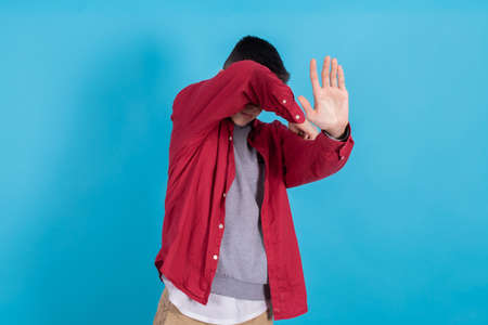 trendy teen boy or student in urban fashion isolated on color background Banco de Imagens