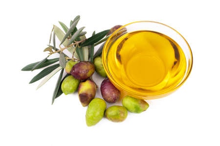 natural olives with olive leaves and oil bowl