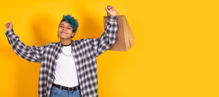 isolated young girl or woman with shopping bags smiling happy Standard-Bild