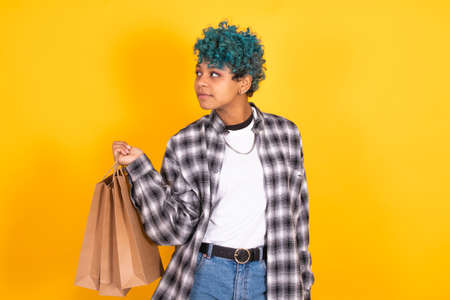 girl with shopping bags or stores isolated on color background