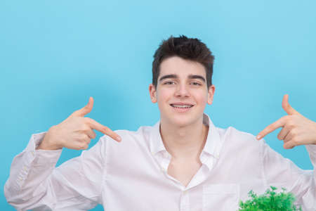 portrait of young teenager man or student isolated on color background