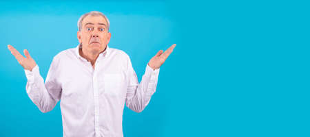 senior man with white shirt isolated on color background