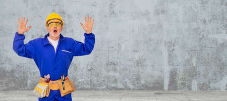 construction worker or worker with tools isolated on background with copy-space Фото со стока