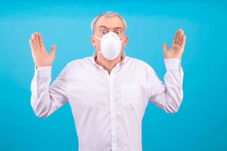 adult man with sanitary mask isolated on color background Stockfoto