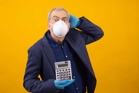 businessman with sanitary mask and calculator isolated on background