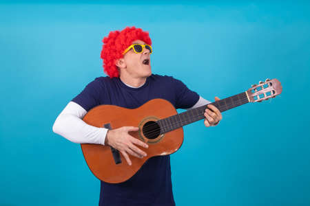 man with funny wig isolated on color background