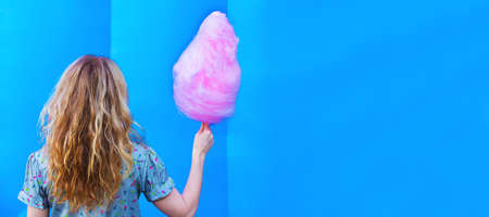 girl or woman with cotton candy and copy space