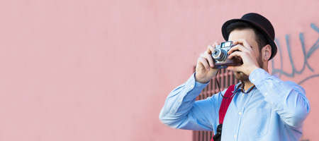 young man traveling with retro photo camera and copy space