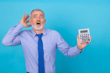 businessman with calculator stressed out and isolated on background