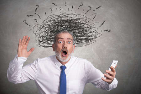 businessman with mobile phone isolated with expression of surprise or amazement