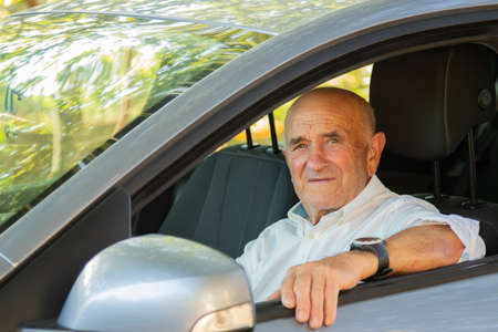 portrait of senior male driving car