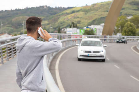man with mobile phone on the road calling assistance Standard-Bild