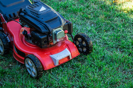lawn mower on the grass with copy space, agricultural and gardening machinery