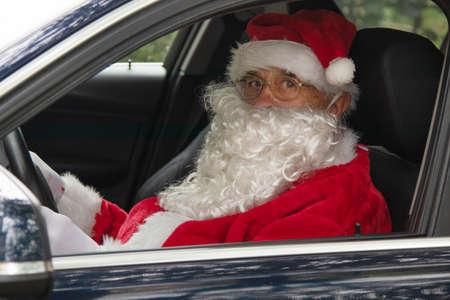 santa claus driving the car at christmas