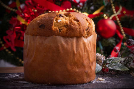 wooden panettone with christmas decorations