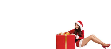 girl in santa claus costume and christmas gift box isolated Stock Photo