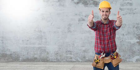 worker or builder with tools on wall background