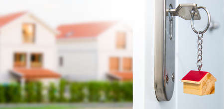 keys in the open door lock with housing 版權商用圖片