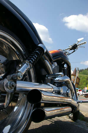 'cycles: View chrome exhaust on Harley chopper. Stock Photo