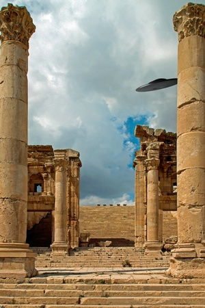 sighting: Columns of the ruins of Jerash, Jordan with a UFO sighting Stock Photo