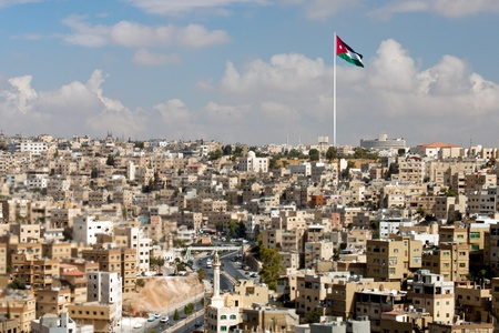 jordan: Panoramic view of the city of Amman with Jordanian flags