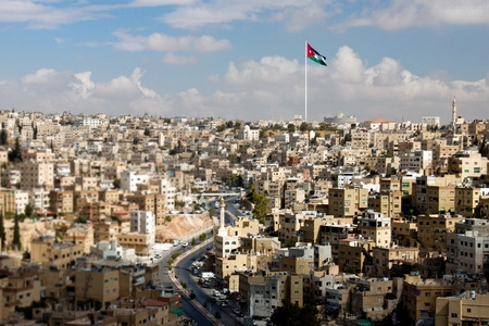 fort: Panoramic view of the city of Amman with Jordanian flags