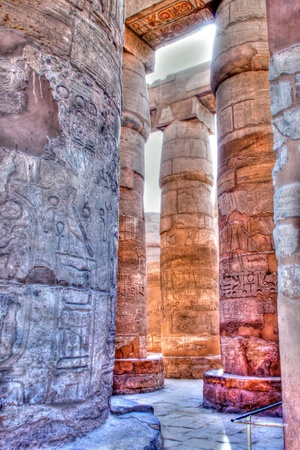 old egypt hieroglyphs carved on the columns of Karnak temple tonemapped (Valley of kings, Egypt) photo